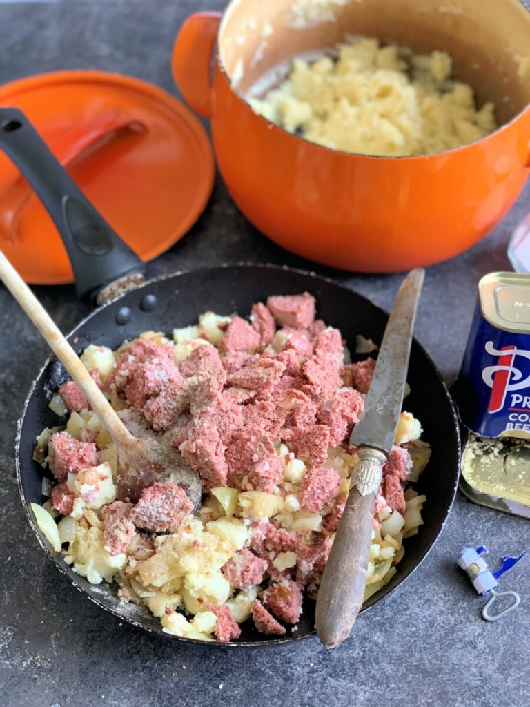 Mash the potatoes with salt and pepper and then add the corned beef; mash them together and then add the fried onions.