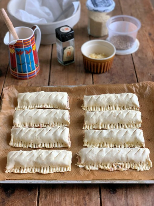 Using a very sharp knife, make several slits on top of the sausage rolls.