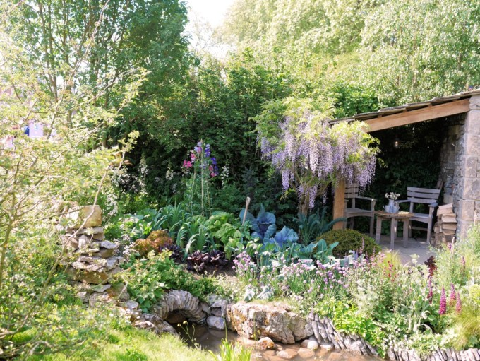 The colour scheme has hints of purple, pink and white with a mixture of dense and varied planting. Dry limestone walls dissect the meadow land and separate the bothy, with its cultivated and romantic cottage garden, from the natural landscape.