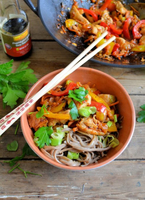 Kung Pao Stir-Fry Chicken and Noodle Bowls - Deliciousbowls of noodles with spicy Kung Pao Chicken & Peppers, all made with ease using Lee Kum Kee's ready-made Kung Pao Chicken Stir-Fry sauce, and on the table in under half an hour.