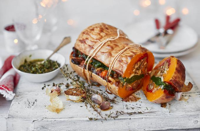 Vegan Christmas Stuffed Roasted Squash with Pesto: this fabulous vegan recipe will be enjoyed by all and makes a stunning centre piece for Christmas Dinner.