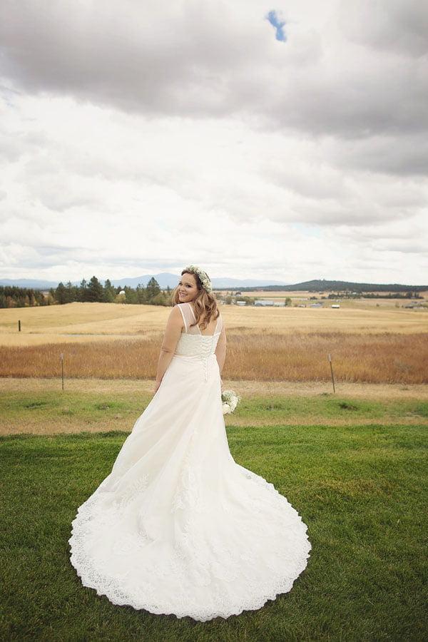 Bride Displaying Dress