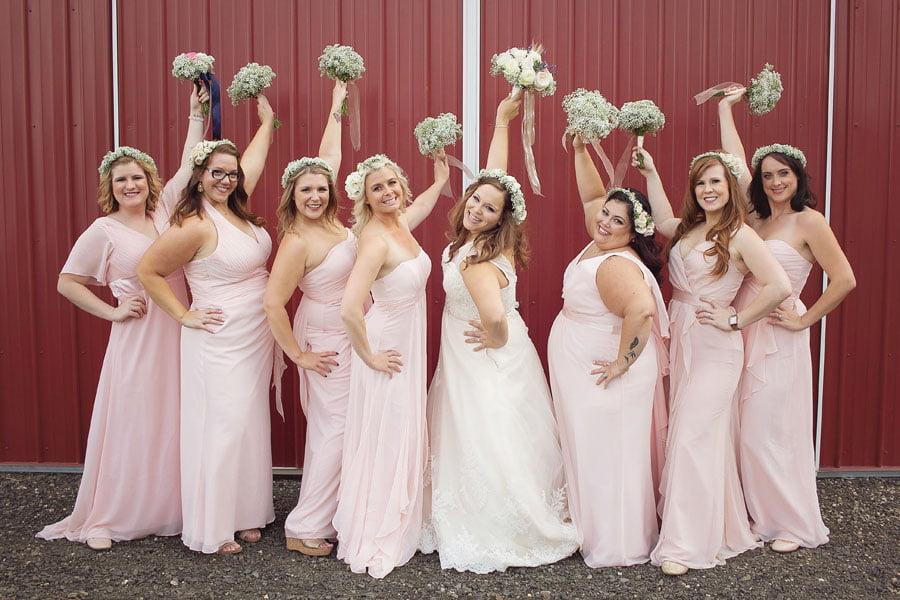Bride and Bridesmaids Raising Bouquets
