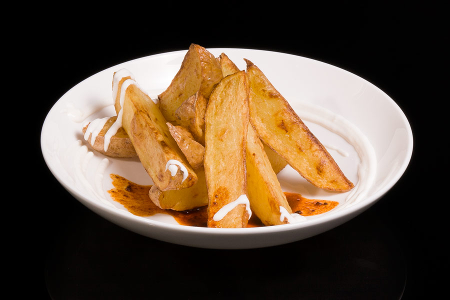 Fried potatoes with spicy sauce and Alioli (garlic mayonnaise)