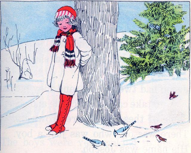 Girl watching birds eat bread crumbs in the snow