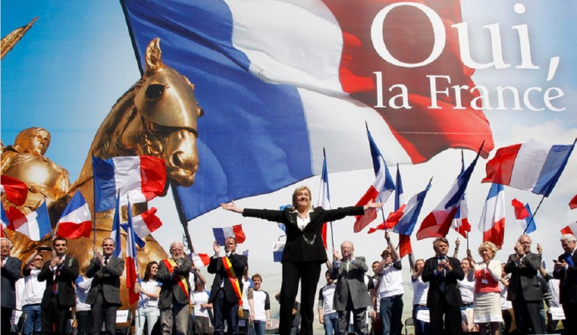France's far right National Front political party leader Marine Le Pen waves on stage during her speech in front of the Opera following the National Front's annual May Day rally in Paris May 1, 2012. REUTERS/Benoit Tessier (FRANCE - Tags: POLITICS)