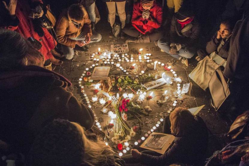 07 Jan 2015, Paris, France --- Paris, France. 7th January 2015 -- A tribute of flowers and candles in the shape of a heart is set up at Place de la RÈpublique in Paris in memory of the victims of a terror attack on the offices of French satirical magazine Charlie Hebdo. -- An estimated 35,000 people gathered at Place de la RÈpublique in Paris to pay tribute to the victims of a terror attack on the offices of French satirical magazine Charlie Hebdo and promote freedom of the press against tyranny and terrorism. --- Image by © David Chour/Demotix/Corbis