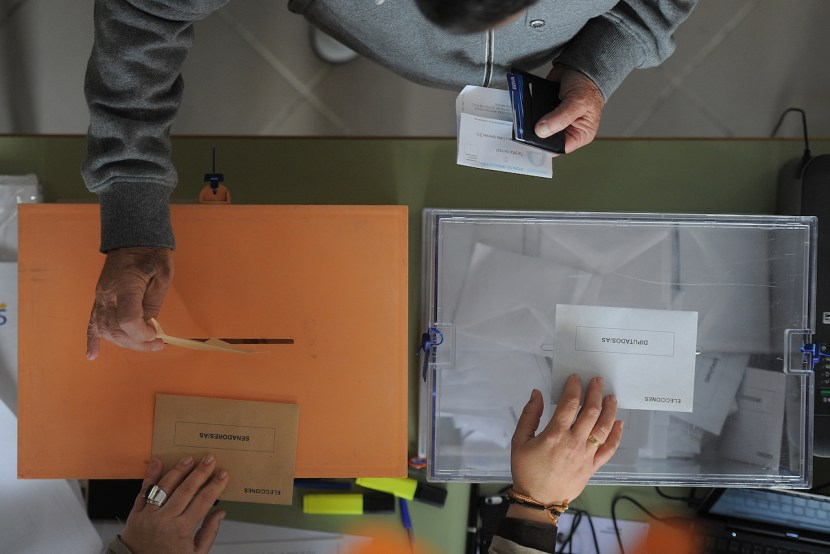 MADRID, SPAIN - DECEMBER 20:  A man casts his ballot at a polling station during General Elections on December 20, 2015 in Madrid, Spain. Spaniards went to the polls today to vote for 350 members of the parliament and 208 senators. For the first time since 1982, the two traditional Spanish political parties, right-wing Partido Popular (People's Party) and centre-left wing Partido Socialista Obrero Espanol PSOE (Spanish Socialist Workers' Party), held a tight election race with two new contenders, Ciudadanos (Citizens) and Podemos (We Can) attracting right-leaning and left-leaning voters respectively.  (Photo by Denis Doyle/Getty Images)