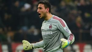 AC Milan's Italian goalkeeper Gianluigi Donnarumma celebrates during the Italian Serie A football match between AC Milan and Inter Milan at San Siro Stadium in Milan on January 31, 2016. / AFP / OLIVIER MORIN (Photo credit should read OLIVIER MORIN/AFP/Getty Images)