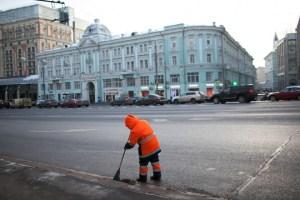 A migrant sweeping Moscow's Tverskaya Ulitsa. David Trilling