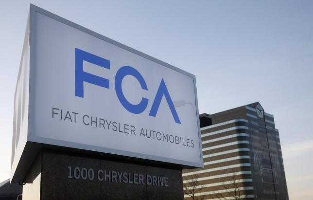 "A new Fiat Chrysler Automobiles sign is pictured after being unveiled at Chrysler Group World Headquarters in Auburn Hills, Michigan May 6, 2014. Fiat Chrysler will build Jeeps in China and Brazil and is expected to invest billions of euros to revamp its battered Alfa Romeo sports-car brand in a bid to convince investors it can turn the newly merged automaker into a thriving global business. Chief Executive Sergio Marchionne unveils the group's long-awaited five-year business plan on Tuesday when he is expected to show how Fiat Chrysler can ""go on the attack against the giants"" in the industry.   REUTERS/Rebecca Cook (UNITED STATES - Tags: TRANSPORT BUSINESS)"