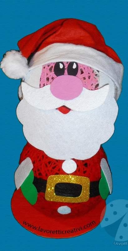Come realizzare un Babbo Natale con palline di lana e colla