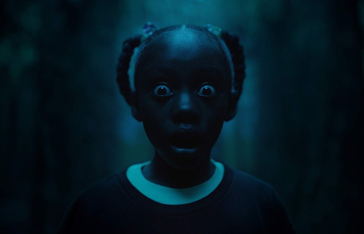 Young Adelaide (Madison Curry) sees her evil self for the first time.; Credit: Universal Pictures