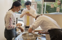 Ally Weldon and Dan Croll practice their pasta-making skills.; Credit: Jessica Chappe
