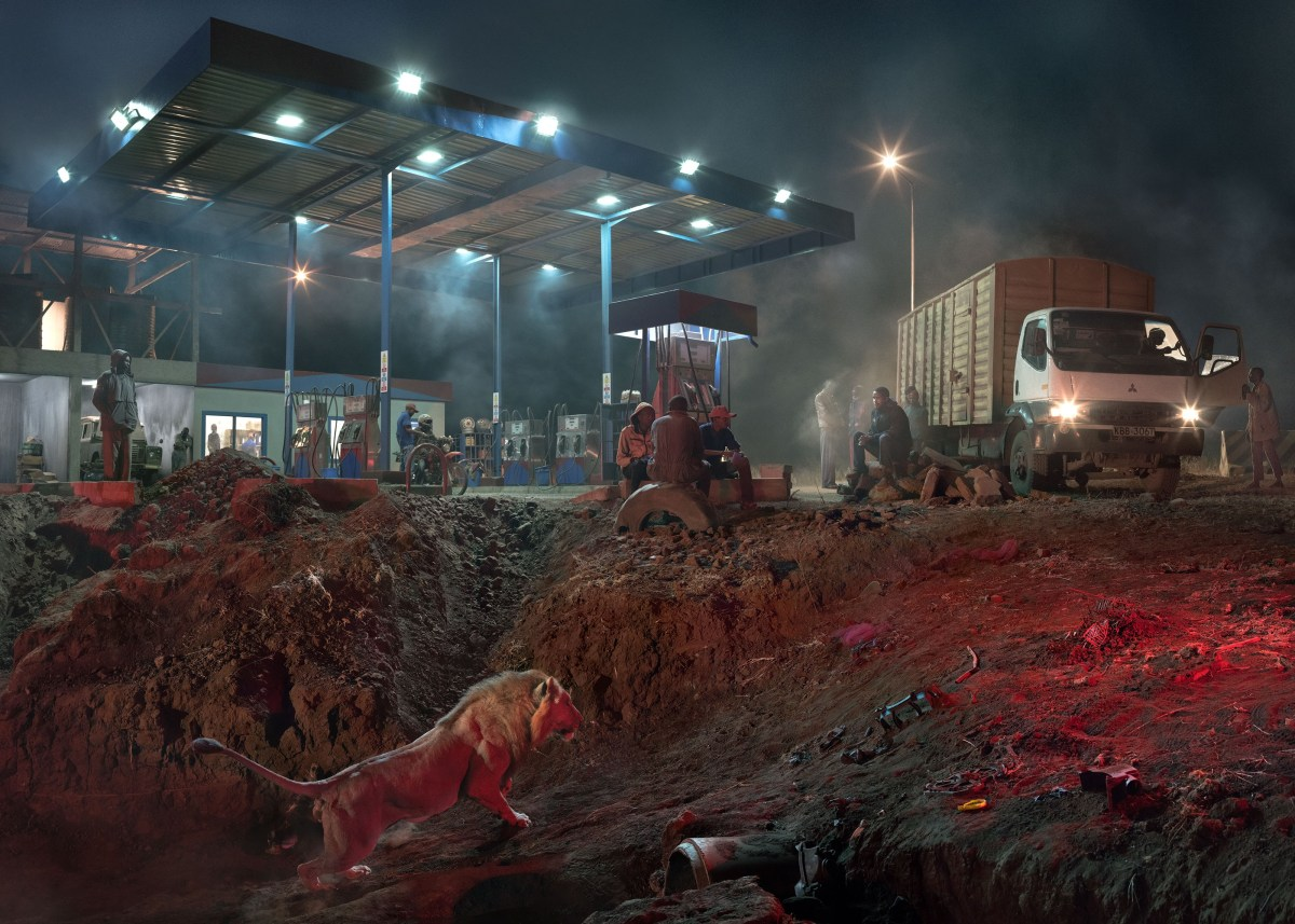 Nick Brandt, Petrol Station With Lion (2018), archival pigment print; Credit: Courtesy of the artist and Fahey/Klein Gallery