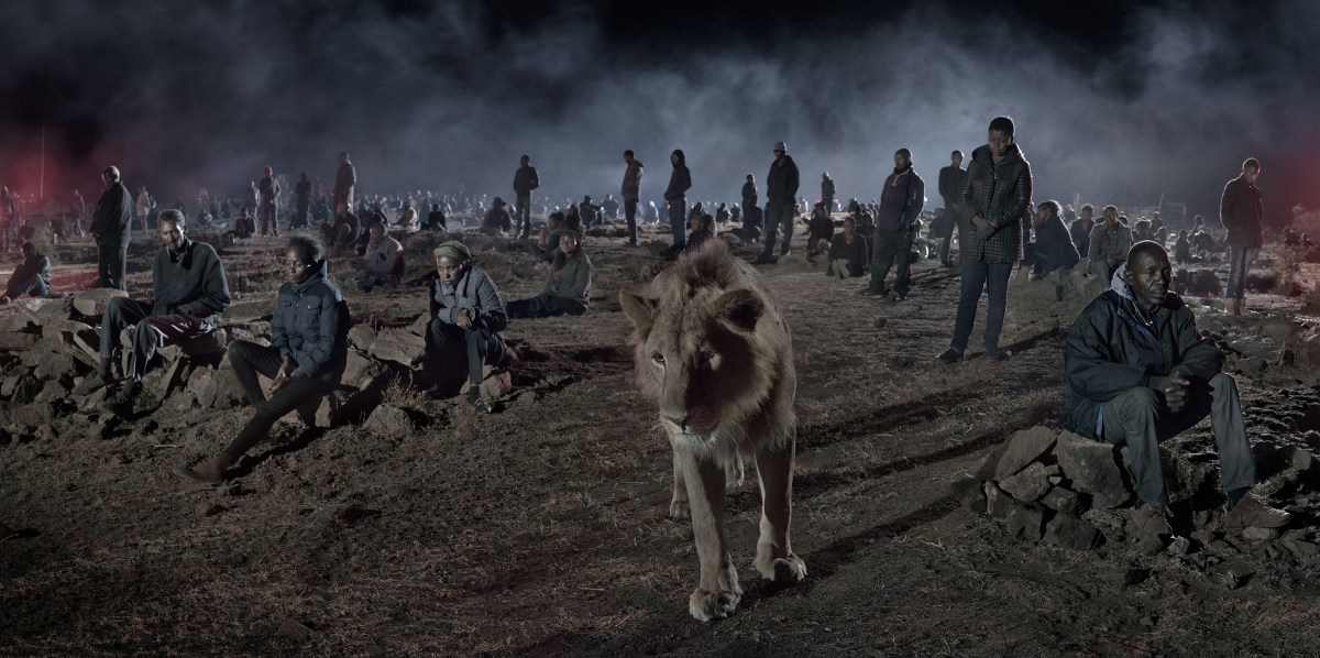 Nick Brandt, Savannah With Lion & Humans (2018), archival pigment print; Credit: Courtesy of the artist and Fahey/Klein Gallery