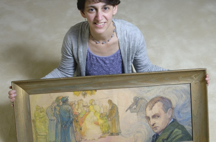 Elizabeth Rynecki with work by her grandfather; Credit: Courtesy of the filmmakers