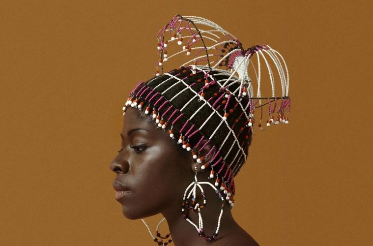 Kwame Brathwaite. Sikolo Brathwaite wearing a headpiece designed by Carolee Prince