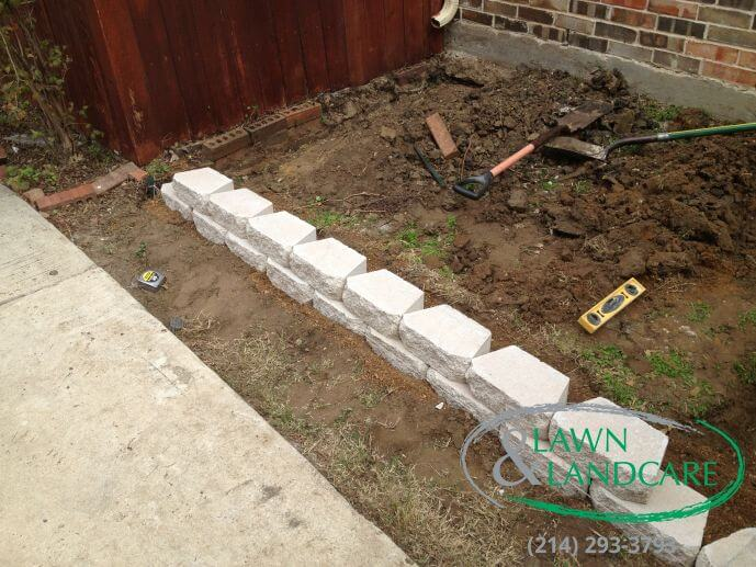 Retaining Wall And French Drain Installed In Carrollton Tx