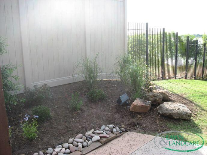 lawn and landcare fenced in yard garden stone