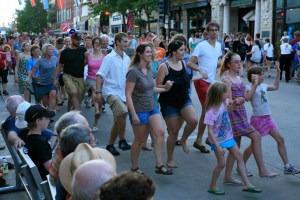 A street dance with live music draws participants of all ages