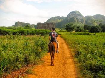 Touring Vinales on horseback.