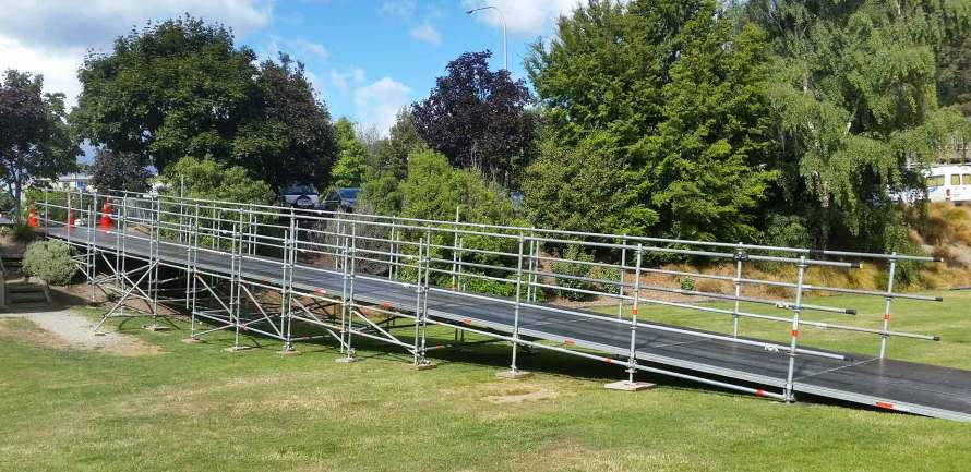 A Layher Event Deck rmap was built from the carpark down to the field to accommodate runners finishing the marathon