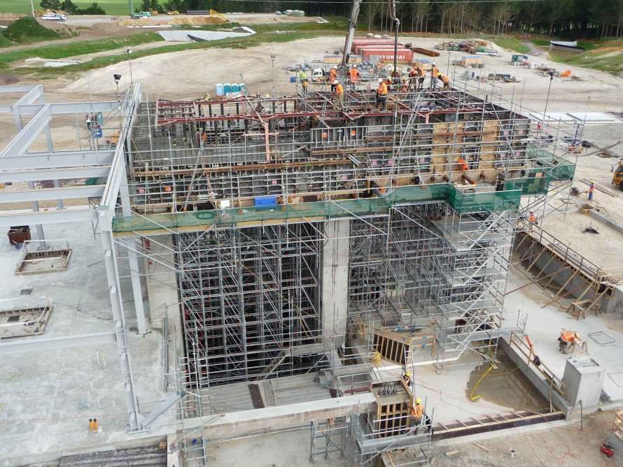 Concrete pur during construction of power station using Layher Allround Scaffolding