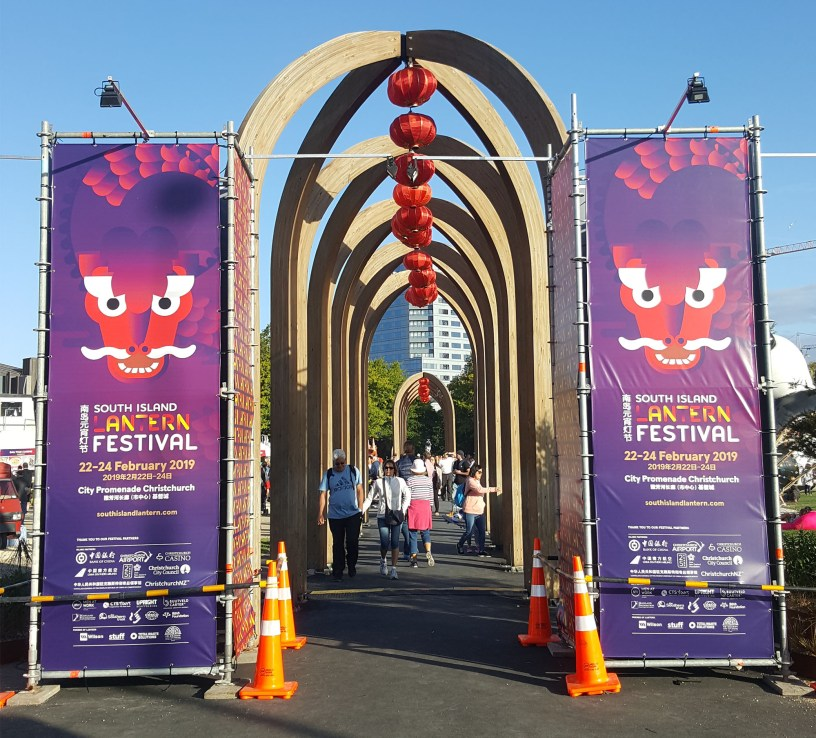 Signage on scaffold towers at Christchurch Lantern Festival erected by Upright Scaffolding