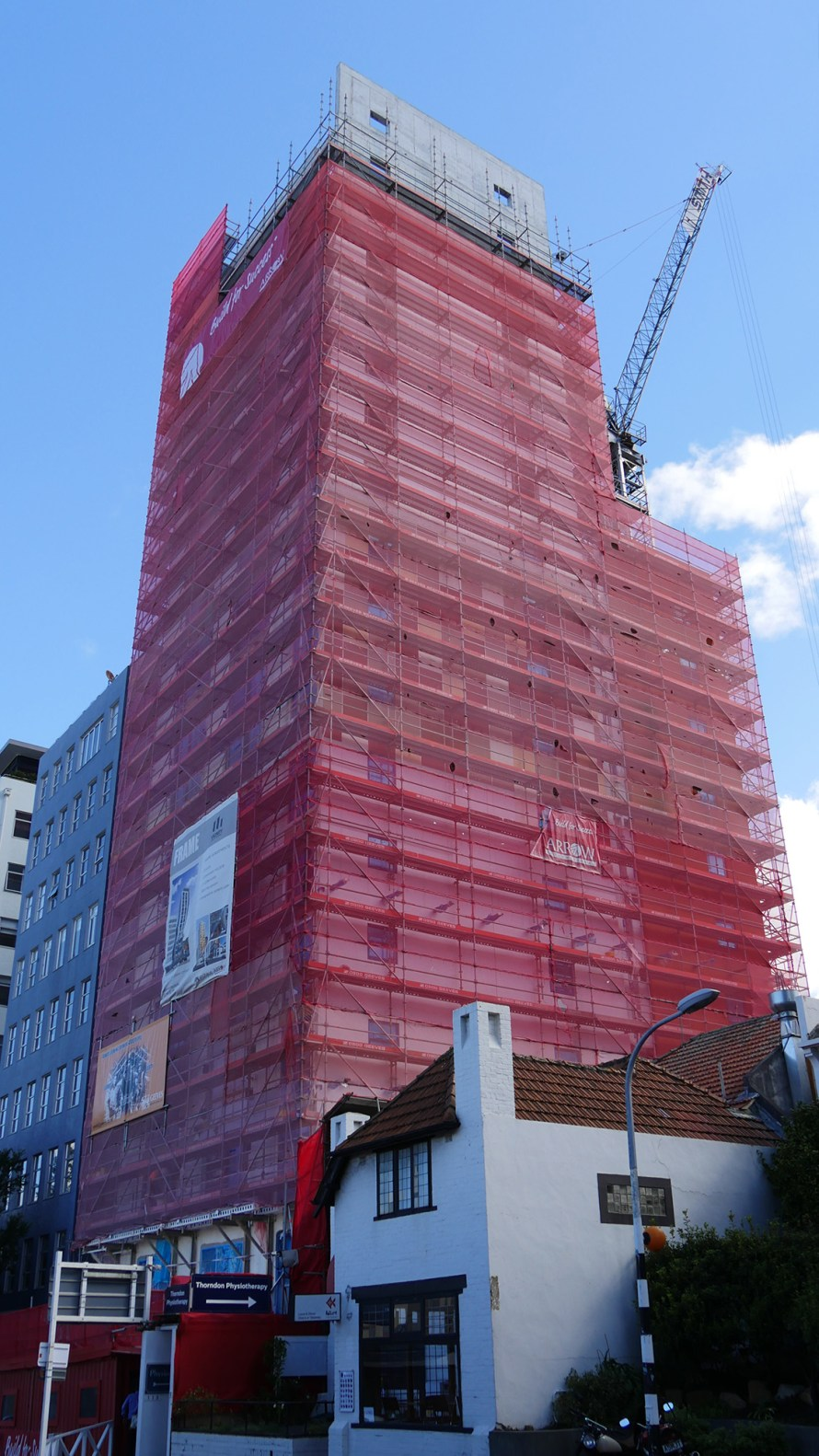 A particularly good innovation was erecting the scaffold on brackets which allowed egress in the event of an emergenc