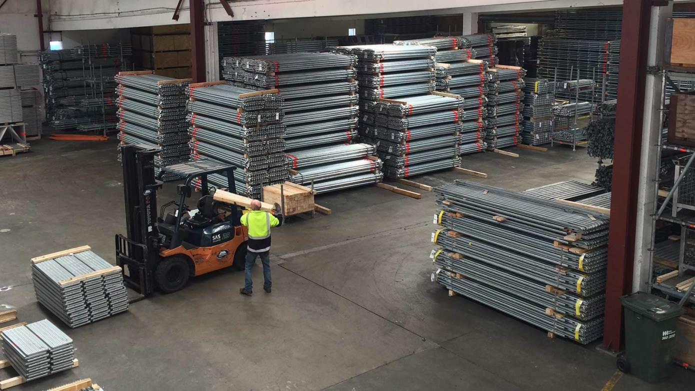 Layher's Wellington yard full of scaffolding supplies for sale