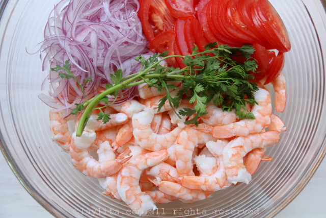 Marinate the shrimp, onions, and tomatoes with the lime juice and cilantro sprig for about 30 minutes