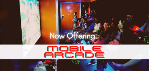 Kids playing inside of the mobile arcade during a party.