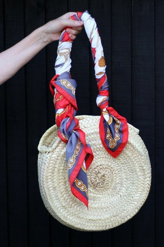 wrap a scarf around the handles of a summer basket