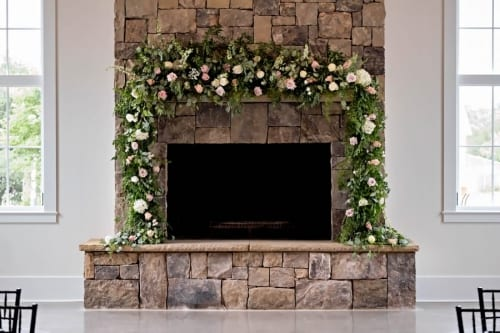 Floral Mantle piece with greenery and greenery framing the Marblegate Farm fireplace