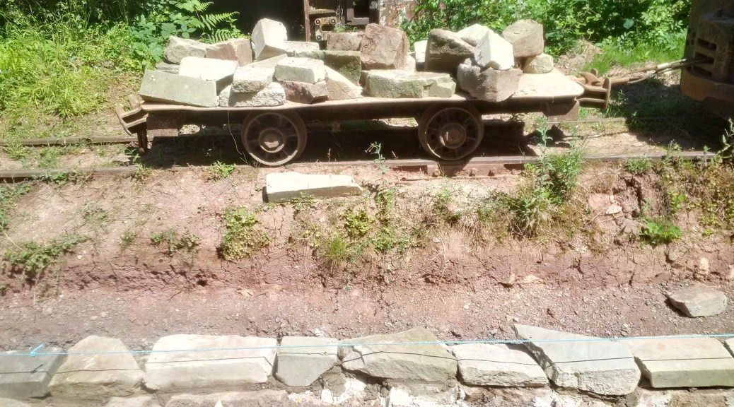 Flat wagon full of stone for the wall