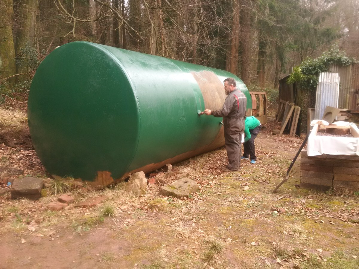 Richard and James painting the tank