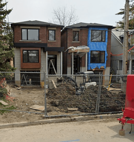Two oversized homes. The result of lot severing.