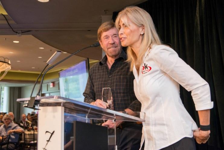 Award recipients Chuck Norris and wife Gena Norris with KICKSTART KIDS
