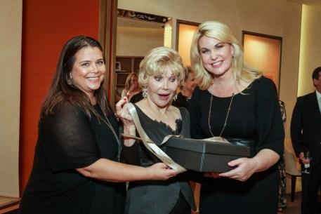 Nathalie Diamantis, Joann King Herring, and Stephanie von Stein giving Joann her lifetime achievement award for the Mission of Yahweh