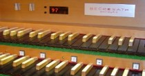 Organ console showing sequencer display and piston buttons