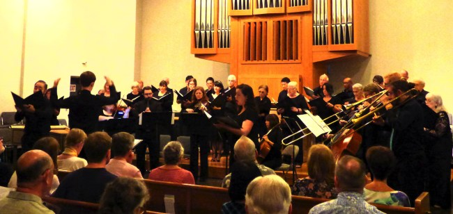 Choir, visiting brass, soloists and strings perform a Schütz piece during the Saturday concert.