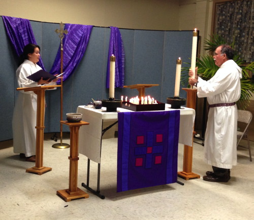 The cantors place the lighted candle at the beginning of worship.
