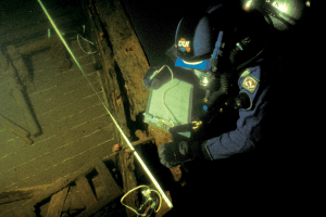 Scuba diver working on a shipwreck