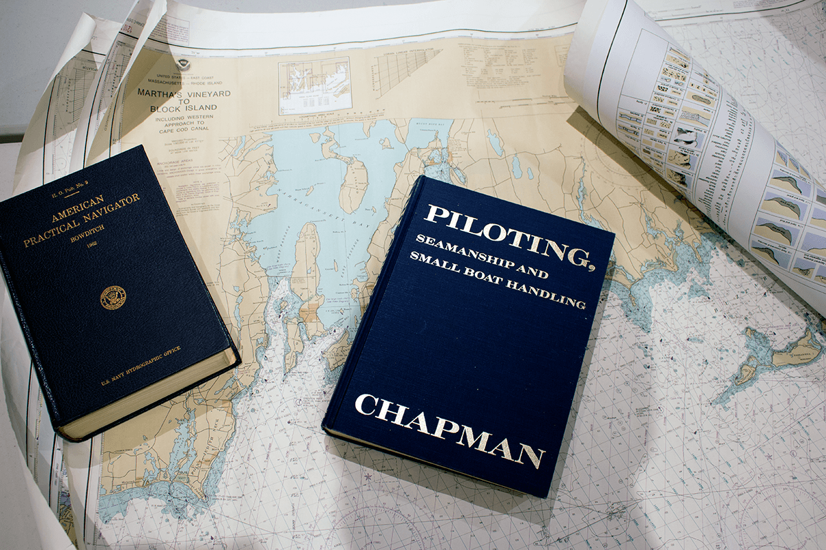 Image of books on navigation and charts for Rhode Island