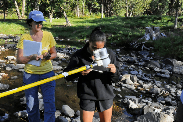 Image of a Watershed Science Apprentice studying a sample.