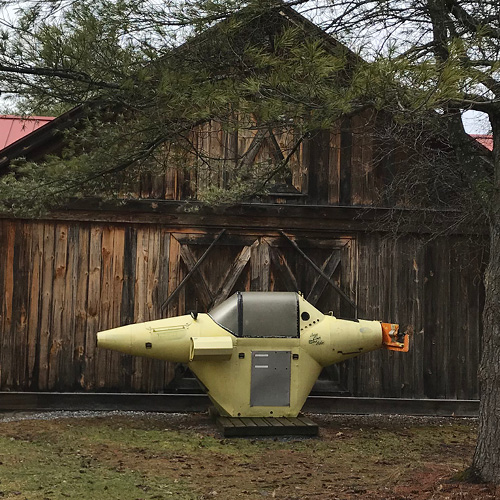 Yellow submarine in front of a building
