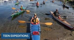 Teens in kayaks coming to shore