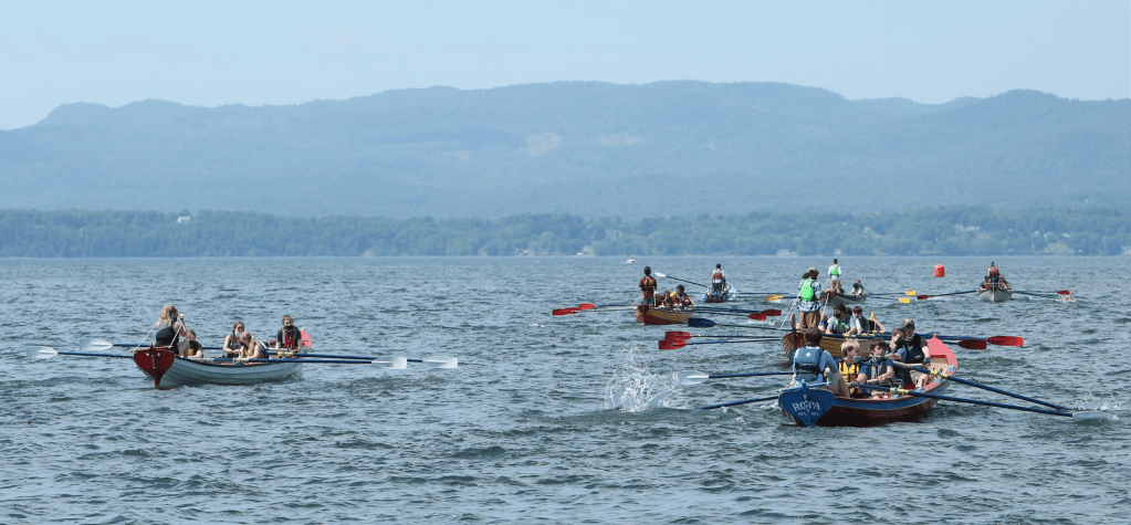 Seven pilot gigs rowed by high school students race across Lake Champlain