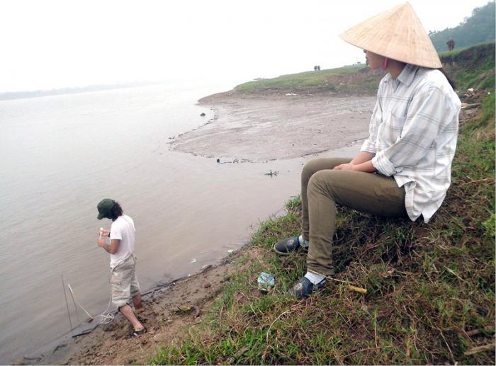 Mason Stahl tests arsenic concentrations in slow-moving water along the edge of the Red River near Hanoi, Vietnam.